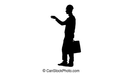 Worker with a diplomat in his hands and a helmet on his head. Silhouette. White background. Slow motion