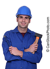 Worker with a mallet