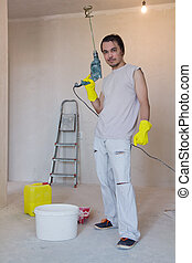 Worker with a power drill