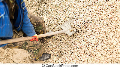 worker with a shovel at the construction site