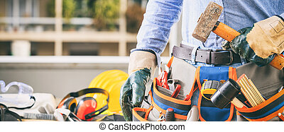 Worker with a tool belt and a hammer