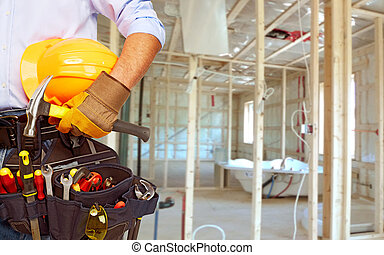 Worker with a tool belt. - Worker with a diy tool belt over...