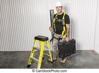 Worker with a tool belt wearing white helmet