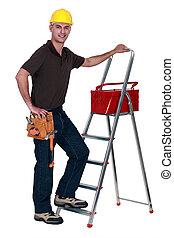 Worker with a toolbox and stepladder