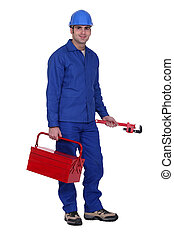 Worker with a wrench and toolbox