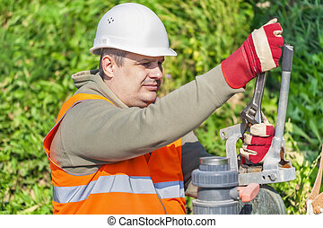 Worker with adjustable wrench