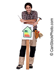 Worker with an energy efficiency sign