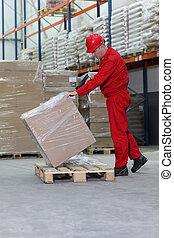worker with bar code reader checking inventory