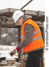 Worker with brick