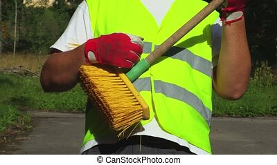 Worker with brush imitate guitar playing
