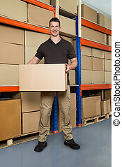 Worker With Cardboard Box In Warehouse