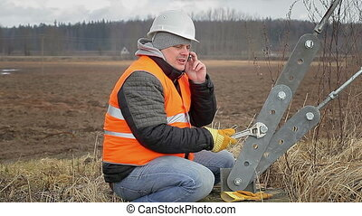 Worker with cell phone