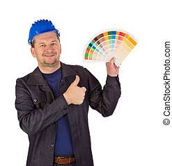 Worker with color samples.