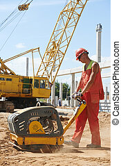 worker with compaction machine - builder worker compacting ...