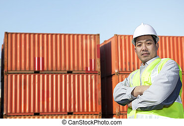 Worker with containers - Portrait of a asian worker in front...