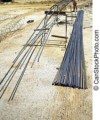 worker with contruction irod lines for building foundation