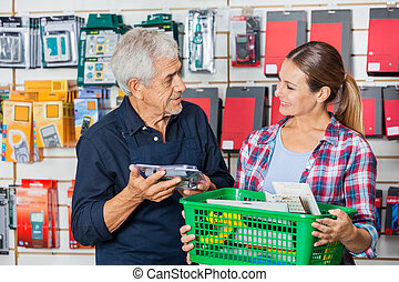 Worker With Customer Holding Tools In Hardware Shop