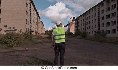 Worker with drone before hand launch