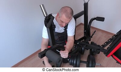 Worker with exercise machine components
