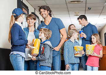 Worker With Families At Cinema