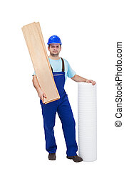 Worker with flooring materials