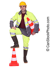 Worker with foot on top of cone signaling