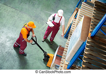worker with fork pallet truck - workers with fork pallet...