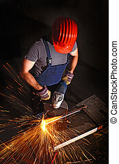 worker with grinder - manual worker work in factory with...