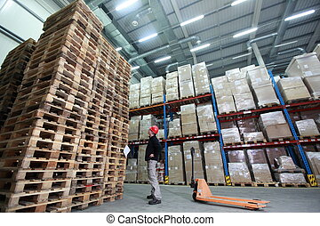 large  stack of wooden pallets