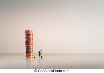 Worker with hand truck full of coins