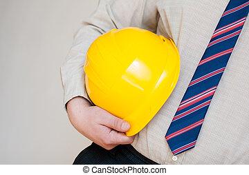 worker with helmet in hand