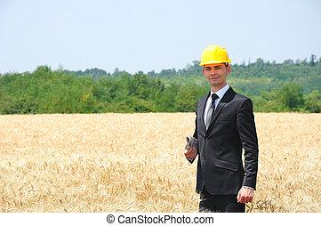 Worker with helmet standing
