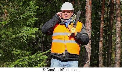 Worker with machete in forest
