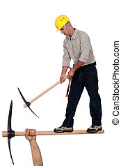 Worker with pick ax