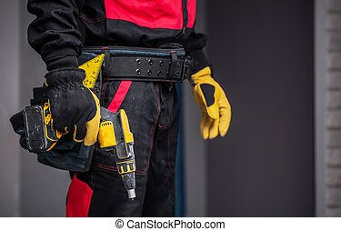 Worker with Power Tool Preparing For Work. Closeup Photo....
