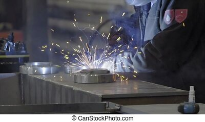 worker with protective mask welding metal (HD)