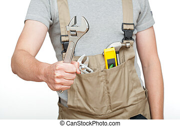 Worker with silver spanner