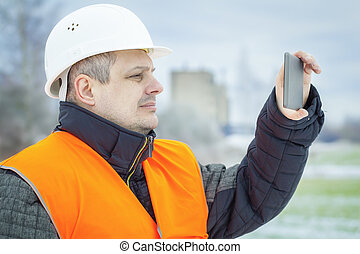 Worker with tablet PC on the field