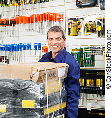Worker With Tool Package In Hardware Shop