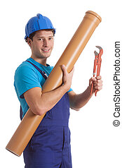 Worker with tube and spanner