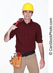 Worker with wrench over his shoulder