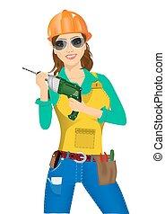 worker woman with drill - portrait of worker woman in orange...