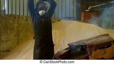 Worker working in foundry workshop 4k
