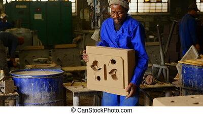 Worker working in foundry workshop 4k - Worker working in ...