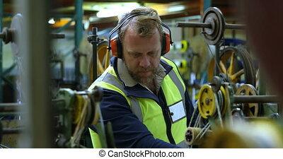 Worker working in rope making industry 4k - Male worker ...