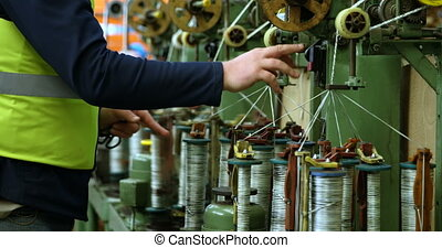 Worker working in rope making industry 4k - Mid section of ...