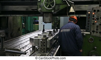 Worker working on milling machine
