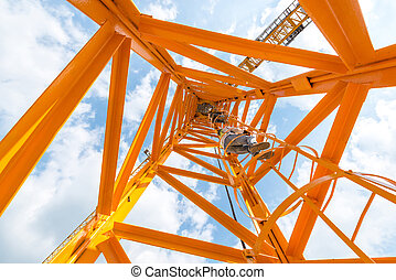 worker working on the construction crane