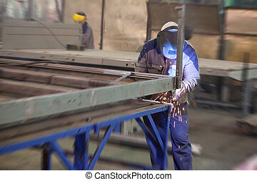 Worker works in a metall work shop