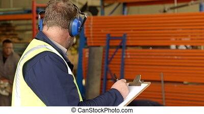 Worker writing on clipboard in rope making industry 4k - ...